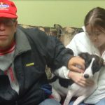 Buster the rat terrier is restored to the family who loves him.